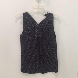 Navy blue and white polka dot sleeveless top